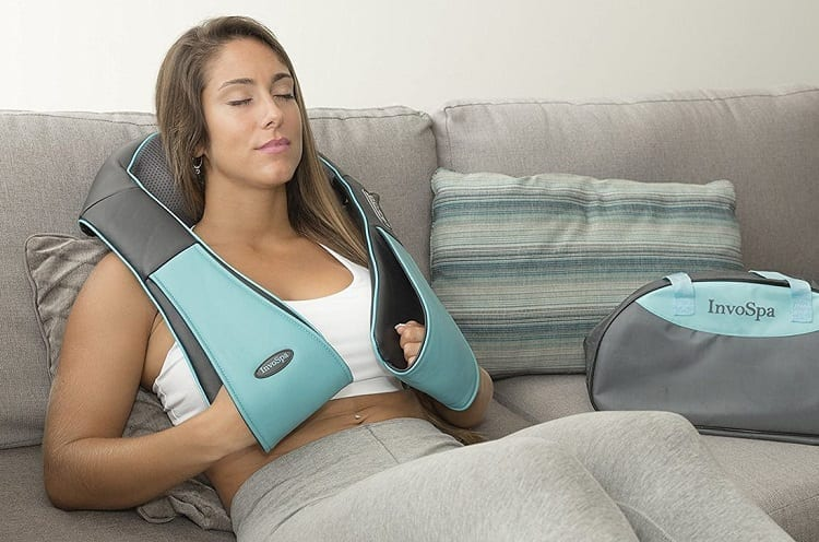 Woman Using Heated Back Massager