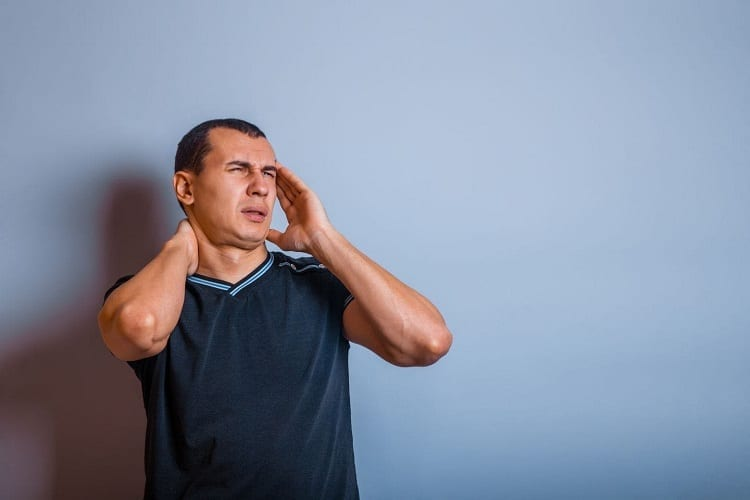 Man Holding For Painful Neck And Head